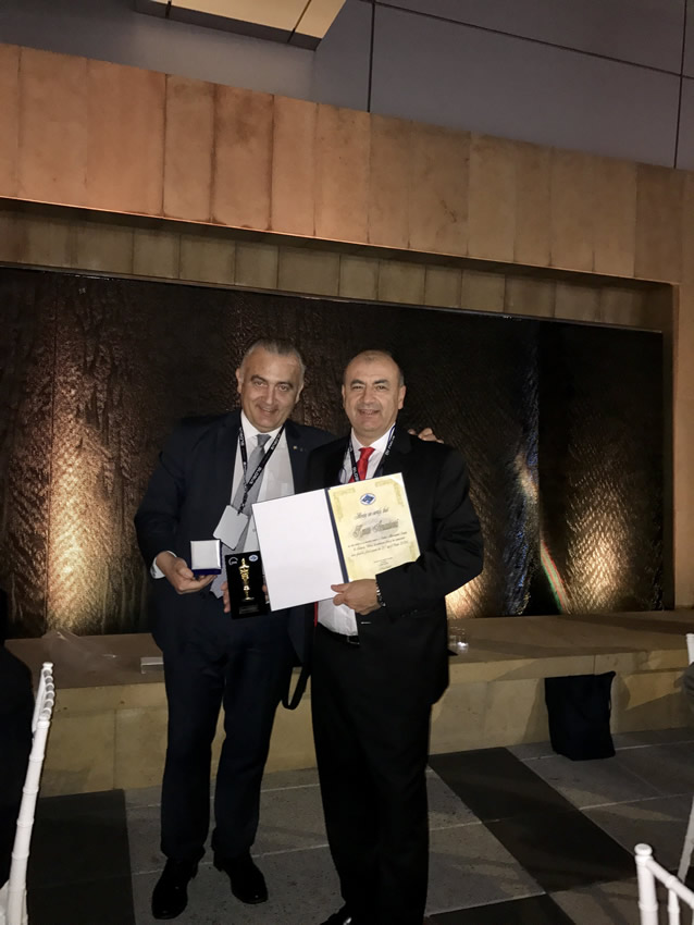 Dr Arnautovic receiving honorary membership of the Serbian Neurosurgical Society from dr Lukas Rasulic